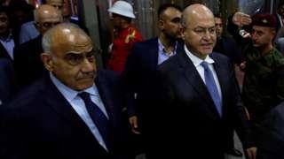 Iraq's Prime Minister-designate Adel Abdul Mahdi (Left) and Barham Saleh (Right) walk out of the Iraqi parliament on 2 October 2018