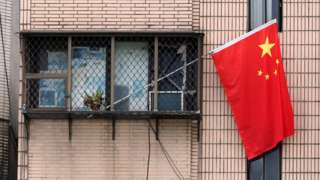 Chinese national flag hanging from a window