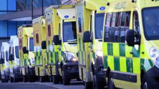 Ambulances queuing outside an NHS hospital