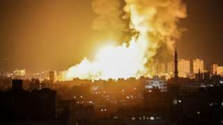 Large plumes of fire and smoke are pictured in Gaza city