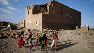 Children play near a building damaged by bombing, Yemen (file pic - November 2018)