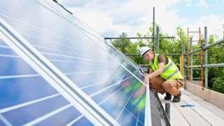 Man fitting solar panel