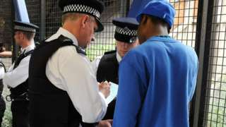 Metropolitan Police officers set up a stop and search operation