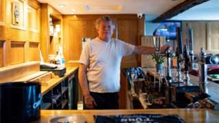 Landlord John Turner in his pub The Dolphin