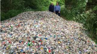 Basingstoke councillor Mark Ruffell (left) and council leader Ken Rhatigan with fly-tipped rubbish