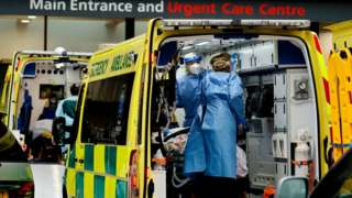 A patient is treated inside an ambulance at Guy's Hospital in central London on Tuesday