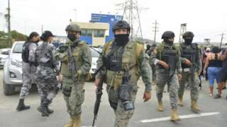 Soldiers patrol outside the high-security prison Zonal 8, in Guayaquil, Ecuador, 02 October 2021.