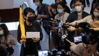 Pro-democracy lawmaker Claudia Mo Man-ching (L) arrives at the Legislative Council to tender her letter of resignation in Hong Kong, China, 12 November 2020
