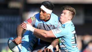 Rey Lee-Lo of Cardiff Blues is tackled by DTH van der Merwe and Huw Jones of Glasgow