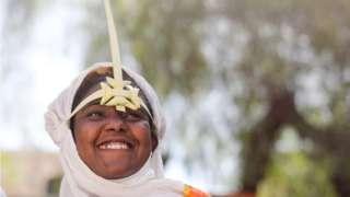 An Ethiopian Orthodox churchgoer wears a palm headdress.