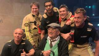 David Hockney and firemen