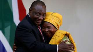 "Nkosazana Dlamini Zuma is congratulated by South Africa""s President Cyril Ramaphosa after being sworn in as South Africa""s Minister of Cooperative Governance and Traditional Affairs in Pretoria, South Africa, May 30, 2019"