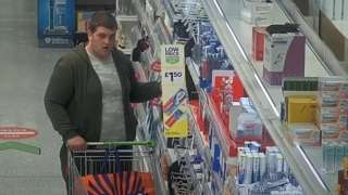 Man putting supermarket items in trolley