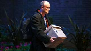Dominic Cummings carrying a cardboard box as he leaves Downing Street on Friday 13 November 2020