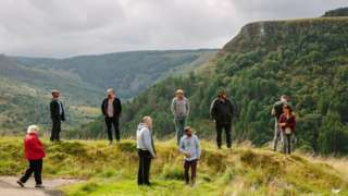 People from Welcome to the woods standing on a ridge