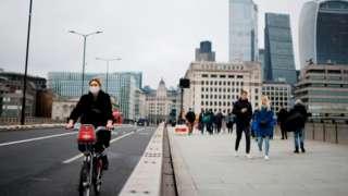 cyclist on a bridge in London