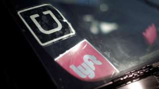 Uber and Lyft logos