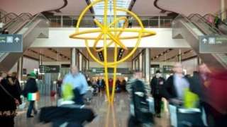 A snapshot of people walking through Dublin Airport