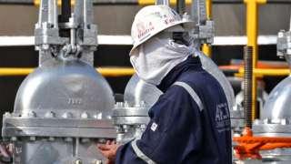 A worker at an oil processing facility of Saudi Aramco in Abqaiq, Saudi Arabia