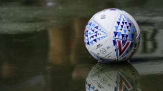 Football in a puddle