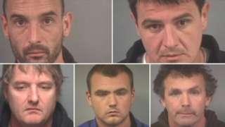 Police mug shots of the five men