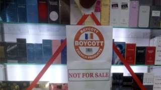 A boycott sign is placed on a showcase displaying French products at a store, in protest against the cartoon publications of Prophet Mohammad in France, in Karachi, Pakistan October 31, 2020.