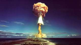 A mushroom cloud after the explosion of a French atomic bomb above the atoll of Mururoa, also known as Aopuni, in 1971