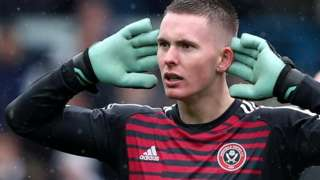 Sheffield United goalkeeper Dean Henderson celebrates their victory at Leeds