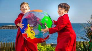 Truro Cathedral Chorister soloists Thomas, 8 and Joseph, 8 play with globe