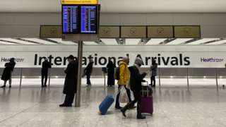 People in arrivals at Heathrow Airport