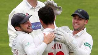 Ruaidhri Smith of Glamorgan celebrates with Andrew Salter and Chris Cooke
