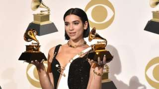 Dua Lipa holds trophies at the 2019 Grammy Awards