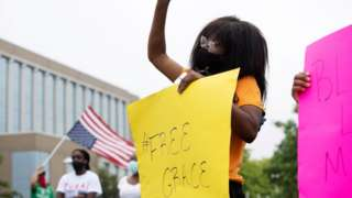 People protest in support of an African-American student who was jailed due to a probation violation of not keeping up with her online schoolwork