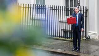 The chancellor with his Budget briefcase