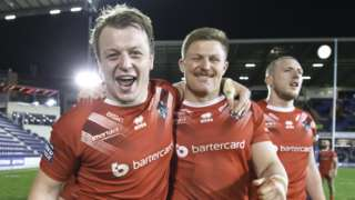 London's Eddie Battye & Luke Yates celebrate victory over Leeds