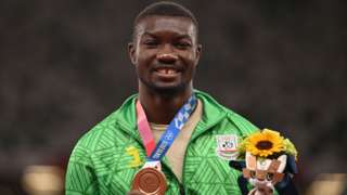 Burkina Faso's Hugues Fabrice Zango with his Olympic triple jump bronze medal
