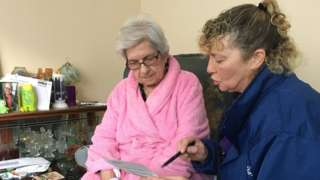 Louise Lumley senior support worker with Age UK Wakefield district and 82 year-old June Lord