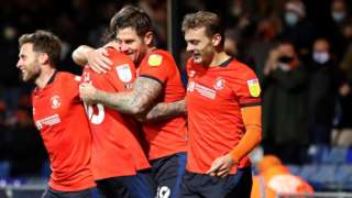 James Collins has scored four of his six goals this season at Kenilworth Road and all against Norwich City