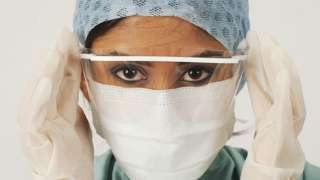 Female medic in a mask