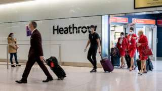 Passengers arrive at Heathrow Airport just in time for Christmas in a few days on December 22, 2020 in London