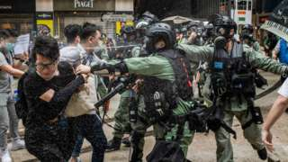 Police pepper spray protesters in Hong Kong