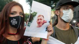 Belarusian activists in Kyiv with photo of fellow activist Vitaly Shishov, found hanged in a park on 3 Aug 21