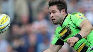 Cobus Reinach of Northampton off loads the ball during the Premiership match between Leicester Tiger