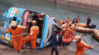 National Disaster Response Force (NDRF) personnel conduct a rescue operation at the site after a bus in fell into a canal in Sidhi Madhya Pradesh, India, 16 February 2021.