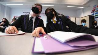 Children wearing facemasks during a lesson at Hounslow Kingsley Academy in West London on 8 March, as pupils in England return to school for the first time in two months as part of the first stage of lockdown easing