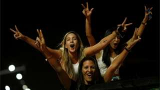 Supporters of Jair Bolsonaro cheer after he was elected president of Brazil