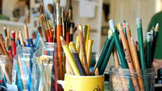 Paint brushes and colouring pencils