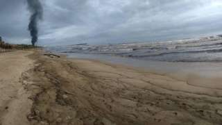 A handout photo made available by environmental activist Samuel Cabrera shows part of the oil contamination at El Palito beach in Puerto Cabello, Venezuela, 10 August 2020 (issued 12 August 2020).