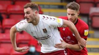 Harry Smith (left) in action for Northampton Town