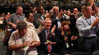 Len McCluskey and other delegates following voting